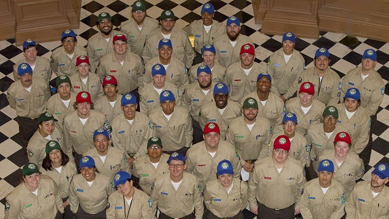 Corpsmembers pose in rotunda of State Capitol