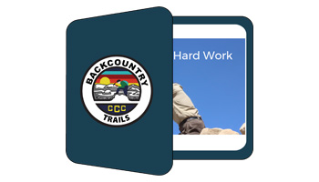 Image illustration depicting a binder with Backcountry Trails logo on front and a slide on the first page of the half open binder.