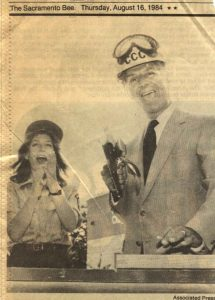 Photo of Sacramento Bee news clipping featuring excited Corpsmember and Gov. Deukmejian holding a power tool