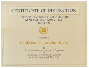 Scanned image, reads Certificate of Distinction, United Nations Headquarters, General Assembly Hall, 5 June 1985, Prested to California Conservation Corps by the United National Environment Programme for outstanding environmental leadership on World Environment Day 1985