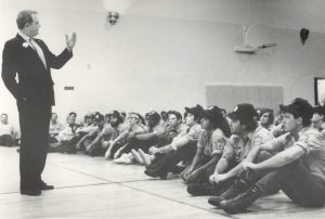 B.T. Collins talks to seated Corpsmembers in 1979