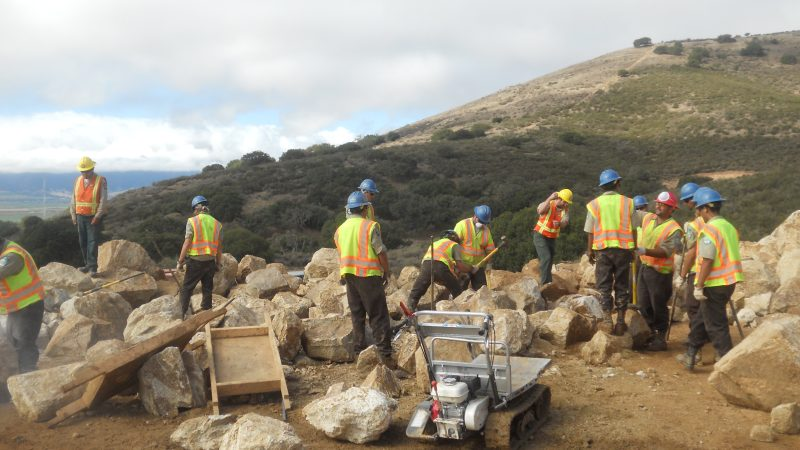 image Corpsmembers move boulders