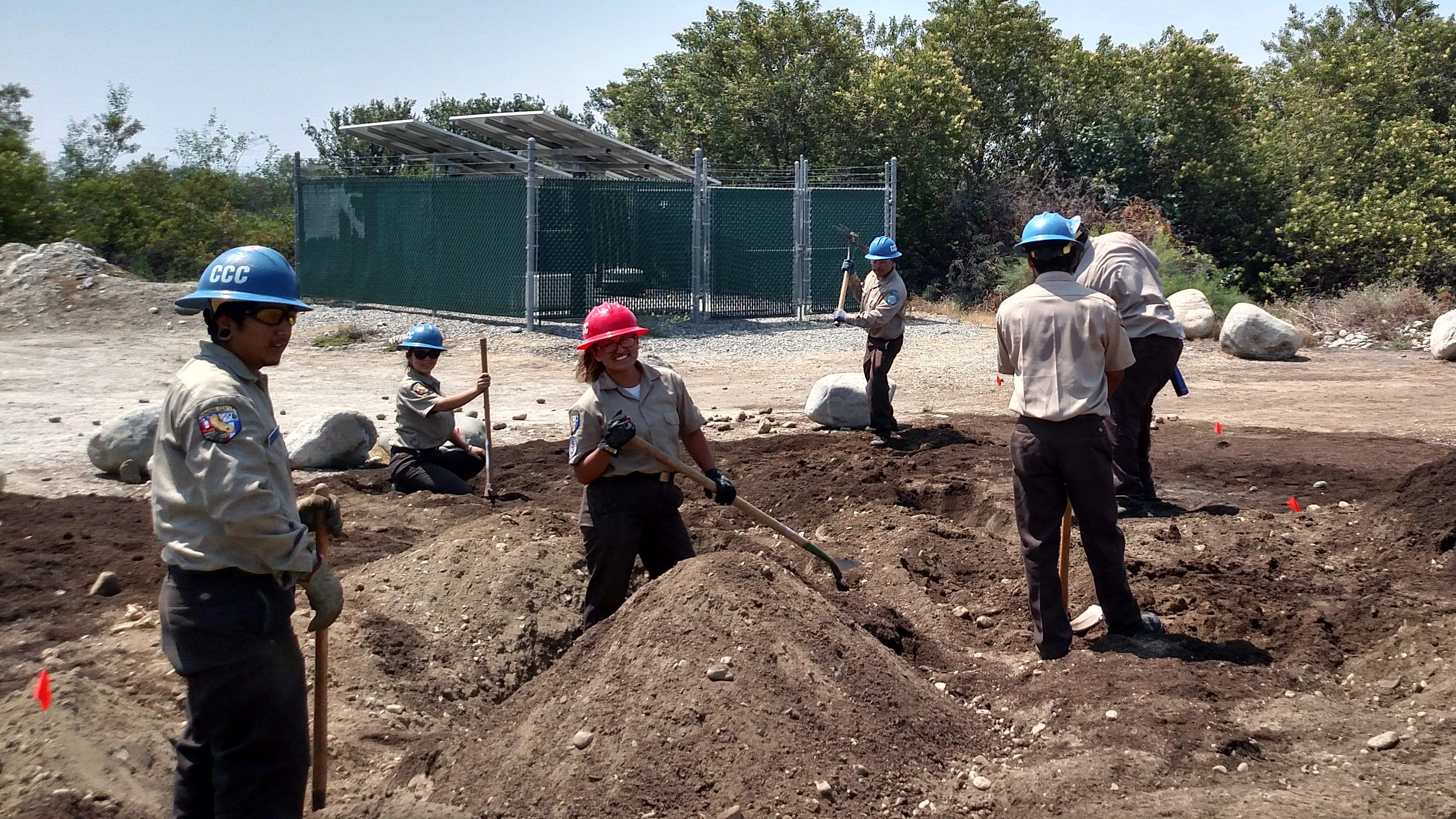 Corpsmembers volunteering at the Drought Tolerant Demonstration Garden.