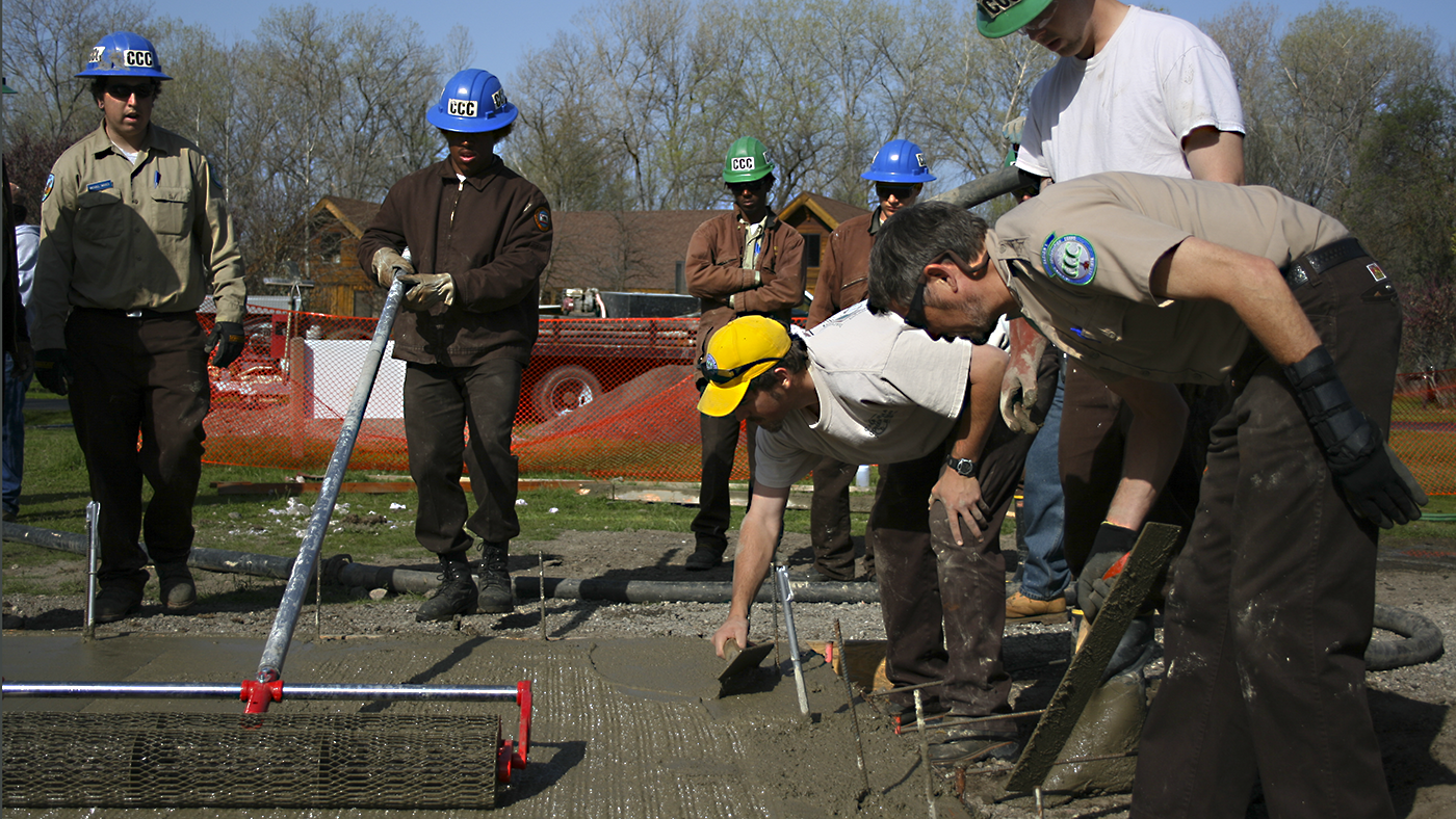 Corpsmembers being trained on the techniques of laying concrete,