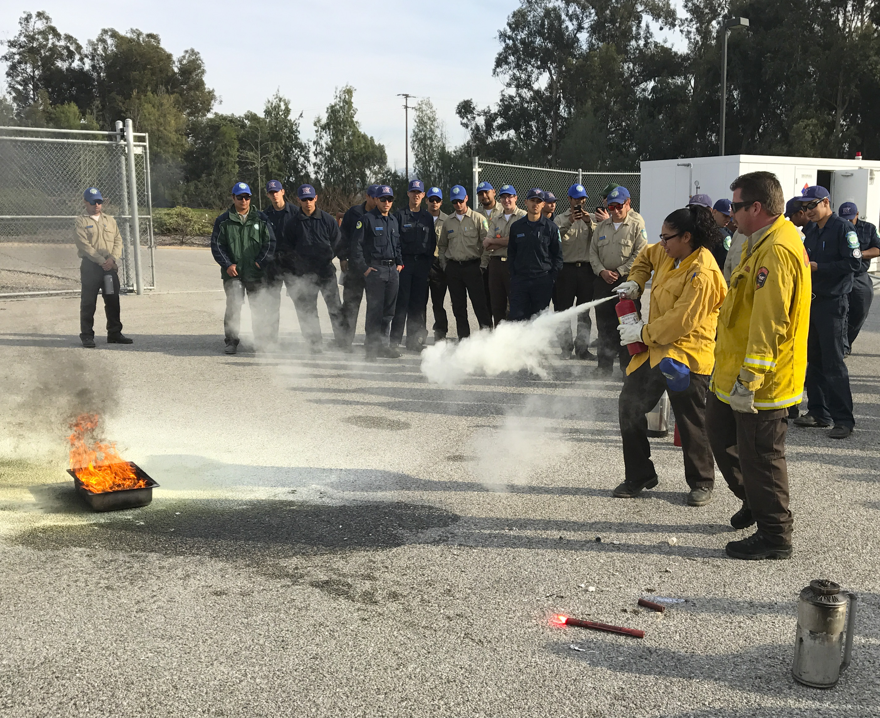 Corpsmembers learning how to use a fire extinguisher properly by Cal Fire.