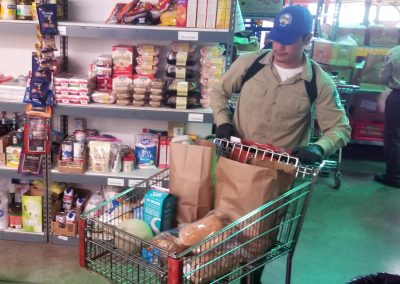 Delta CM With Shopping Cart At Interfaith Food Bank