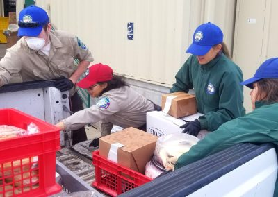 Delta Corpsmembers Load Up Truckbed with Food