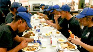 Corpsmembers eating breakfast.